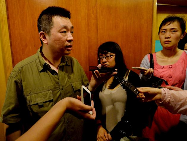 Family members of passengers on the ship which sank at the Jianli section of Yangtze River participate in an interview in Shanghai