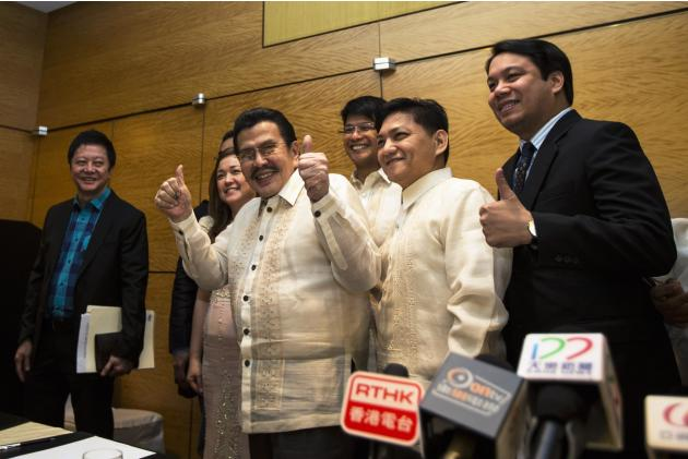 Manila mayor Joseph Estrada thumbs up after news conference in Hong Kong