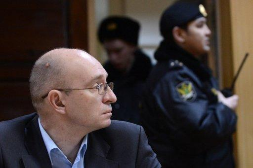 Dmitry Kratov sits in court in Moscow on Friday. A Moscow court on Friday acquitted a former top prison official who had been accused of negligence over the death in detention of lawyer Sergei Magnitsky in 2009, an incident that caused major tensions with the United States.