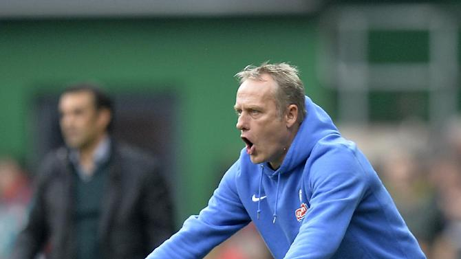 Freiburg's head coach Christian Streich reacts during the German first division Bundesliga soccer match between Werder Bremen and SC Freiburg in Bremen, Germany, Saturday, Oct. 19, 2013