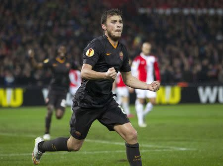 Adem Ljajic of AS Roma celebrates his goal against Feyenoord during their Europa League round of 32 second leg soccer match at the Kuip stadium in Rotterdam