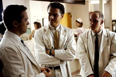 Frank Abagnale ( Leonardo DiCaprio ) poses as a doctor and intimidates two residents, Dr. Ashland  ( Johnathan Brent ) and Dr. Harris ( Shane Edelman ),in Dreamworks' Catch Me If You Can