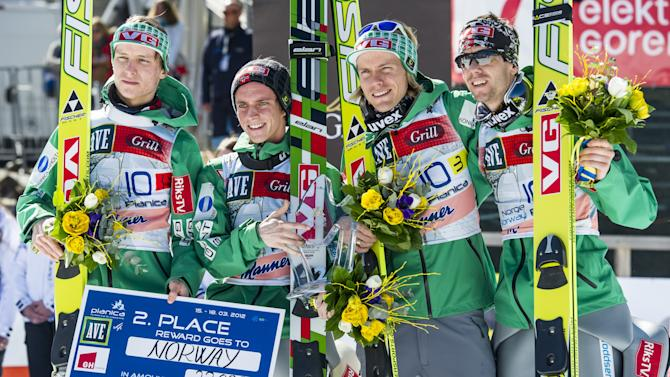 (L-R) Norway's Rune Velta, Anders Fannemel, Bjoern Einar Romoeren, Anders Bardal pose after taking second place of the FIS Ski Flying World Cup Team event in Planica on March 17, 2012.   AFP PHOTO / Jure Makovec (Photo credit should read Jure Makovec/AFP/Getty Images)