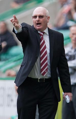 Manager John McGlynn, pictured, and six players did not receive their October salaries on schedule