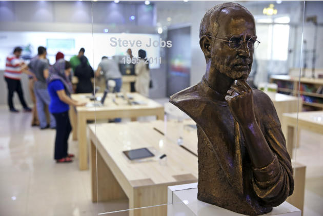 In this  Friday, July 17, 2015 photo, a statue of the late Apple CEO and co-founder, Steve Jobs, is displayed at an Apple store in an electronics mall, in downtown Tehran, Iran. While it will likely b
