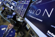 FILE - In a Tuesday, March 15, 2016 file photo, specialist Ronnie Howard works under the Avon logo on the floor of the New York Stock Exchange. On Thursday, Feb. 16, 2017, Avon Products Inc. is reporting a loss of $10.7 million in its fourth quarter. (AP Photo/Richard Drew)