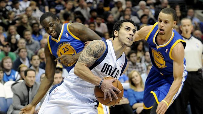 Dallas Mavericks point guard Shane Larkin drives past Golden State Warriors small forward Draymond Green (23) and point guard Stephen Curry (30) in the first half during an NBA basketball game on Wednesday, Nov. 27, 2013, in Dallas
