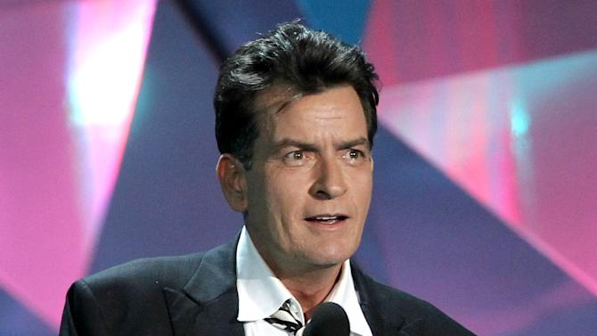 "FILE - This June 3, 2012 file photo shows actor Charlie Sheen at the MTV Movie Awards in Los Angeles. In an interview Tuesday, July 17, on Ryan Seacrest's radio show, Sheen said ""American Idol"" producer Nigel Lythgoe publicly threw his name out there as a possible judge and the idea peaked his interest. Sheen told Jay Leno Monday night on ""The Tonight Show"" that his two demands would be that FX and his ""Anger Management"" team ""would have to be into it"" and there would need to be a charitable component to him taking the job. (Photo by Matt Sayles/Invision/AP, file)"