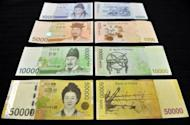 This file illustration photo shows various South Korean banknotes. South Korea's central bank has kept its key interest rate unchanged at 3.0 percent, defying expectations that it would take advantage of low inflation to announce an economy-boosting cut
