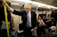 London Mayor Boris Johnson travels on a London underground train in north London on May 3, 2012. A cable car has been strung over the Thames, an athletes' terminal built at Heathrow Airport, and Olympic traffic lanes set up -- yet Londoners still fear the Games will bring their city to a standstill