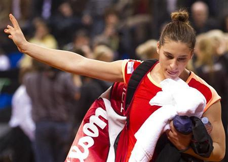Germany's Petkovic leaves court after losing to Australia's Stosur during their Fed Cup World Group tennis match in Stuttgart
