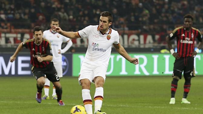AS Roma midfielder Kevin Strootman, of the Netherlands, scores on a penalty kick during the Serie A soccer match between AC Milan and Roma at the San Siro stadium in Milan, Italy, Monday, Dec. 16, 2013