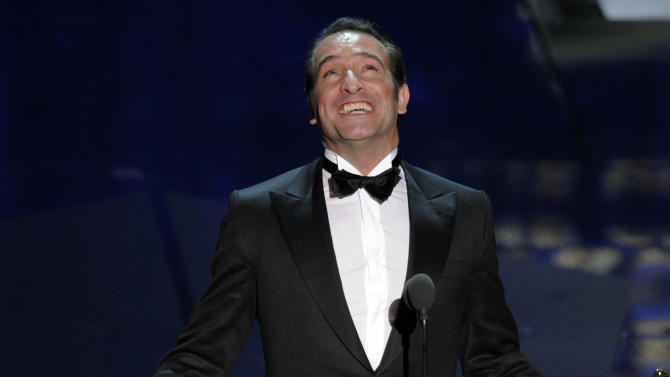 """Jean Dujardin accepts the Oscar for best actor in a leading role for """"The Artist"""" during the 84th Academy Awards on Sunday, Feb. 26, 2012, in the Hollywood section of Los Angeles. (AP Photo/Mark J. Terrill)"""