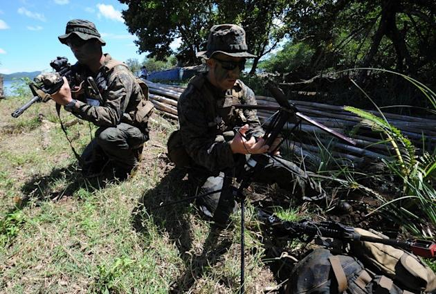 US soldiers prepare communication equipment during a joint exercise on the shore of Ulugan Bay, on Palawan island, on April 25, 2012. The Philippines and the United States have begun talks aimed at allowing a bigger US military presence on the soil of its key Asian ally, amid tensions with China