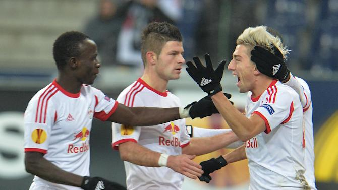 Salzburg's Kevin Kampl, right, celebrates with Sadio Mane, left, and Valon Berisha  after scoring  during the Europa League group C soccer match  between Red  Bull Salzburg and Esbjerg fB  in Salzburg , Austria, Thursday, Dec  12, 2013