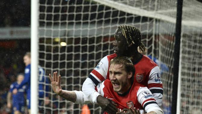 Arsenal's Bendtner celebrates his goal against Cardiff City with Sagna during their English Premier League soccer match in London