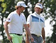 Webb Simpson and Bubba Watson walk toward the 9th green during the first round of the 2012 Travelers Championship at TPC River Highlands, on June 21, in Cromwell, Connecticut