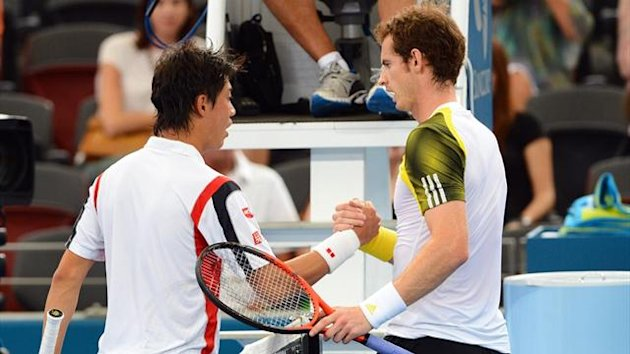 Kei Nishikori of Japan (L) shakes hands with Andy Murray of Britain (R) after retiring injured from their semi-final match at the Brisbane International (AFP)
