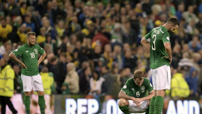 Ireland's Pilkington, Whelan and Wilson react after losing their World Cup qualifying match against Sweden in Dublin