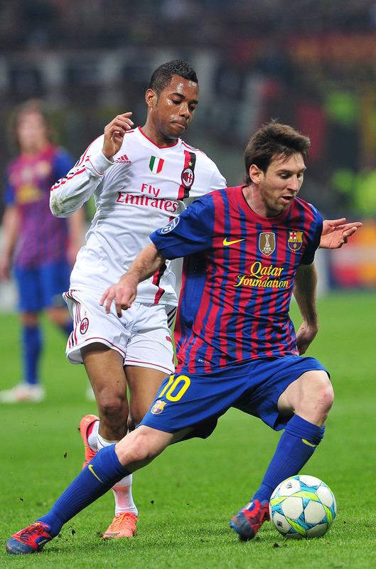 Barcelona's Argentinian Forward Lionel Messi (R) Fights AFP/Getty Images