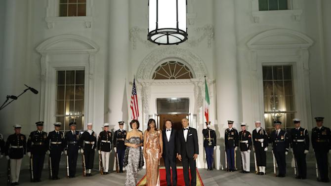 President Barack Obama and first lady Michelle Obama with Italian Prime Minister Matteo Renzi and his wife Agnese Landini on the North Portico for a State Dinner at the White House in Washington, Tuesday, Oct. 18, 2016. (AP Photo/Pablo Martinez Monsivais)