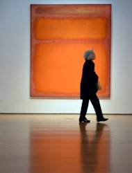 "Mark Rothko's ""Orange, Red, Yellow"" on display at Christie's in New York on May 4. The painting became the world's most expensive contemporary art work when it fetched $86.9 million in a stunningly lucrative auction at Christie's"