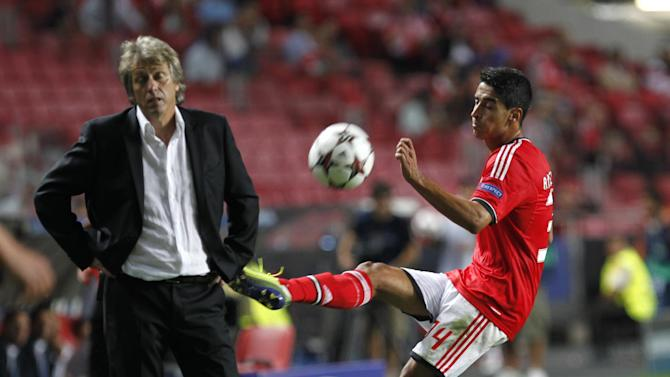 Benfica's coach Jorge Jesus reacts next to Benfica's Andre Almeida during the Champions League group C soccer match between Benfica and Anderlecht Tuesday, Sept. 17, 2013, at Benfica's Luz stadium in Lisbon