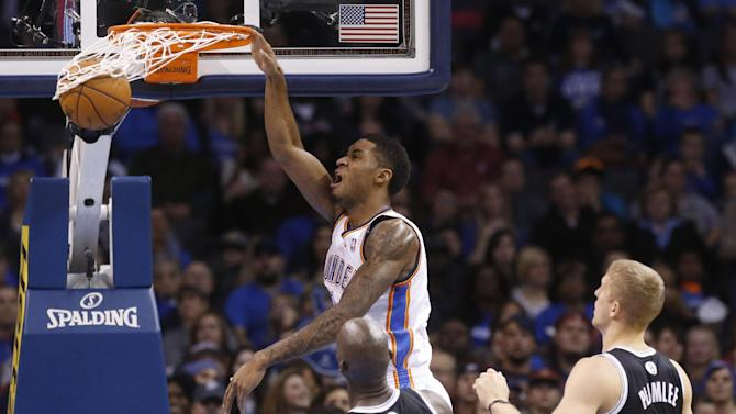 Oklahoma City Thunder forward Perry Jones (3) dunks in front of Brooklyn Nets center Kevin Garnett and forward Mason Plumlee (1) in the second quarter of an NBA basketball game in Oklahoma City, Thursday, Jan. 2, 2014