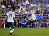 Italian midfielder Daniele De Rossi tries an overhead kick during the Euro 2012 football championships against Republic of Ireland. Italy won 2-0 and went on to make the final, losing to Spain.