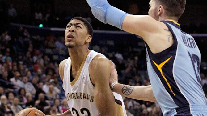 New Orleans Pelicans forward Anthony Davis (23) goes up against Memphis Grizzlies forward Mike Miller (13) in the second half of an NBA basketball game in New Orleans, Wednesday, March 12, 2014. The Grizzlies won 90-88