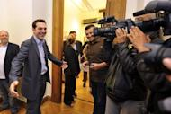 Greek poll front-runner Alexis Tsipras, pictured in parliament on Friday, says forcing his country out of the eurozone would sink the region as a whole