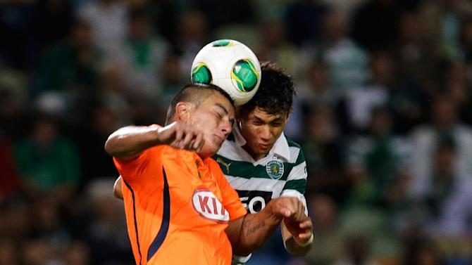 Sporting's Montero, from Colombia, right, heads the ball with Setubal's Javier Cohene, from Paraguay, during their Portuguese league soccer match Saturday, Oct. 5 2013, at Sporting's Alvalade stadium in Lisbon