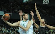 Britain's Joel Freeland (L) during a Euroleague basketball match in January. Great Britain, 350-1 underdogs to win gold in London, have just two NBA players on their roster, the 6ft 10in forward Freeland and Chicago Bulls All Star Luol Deng