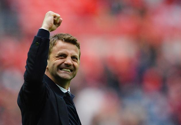 Aston Villa's English manager Tim Sherwood raises his fist after winning the FA Cup semi-final between Aston Villa and Liverpool at Wembley stadium in London on April 19, 2015