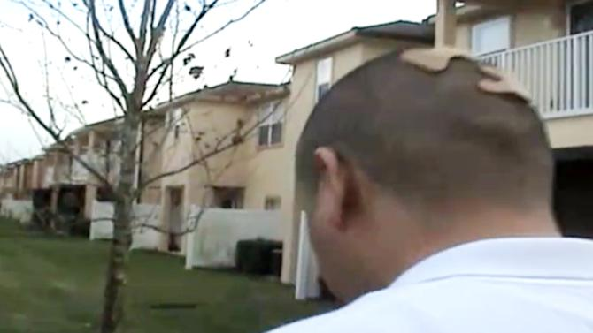 In this Feb. 27, 2012 image taken from a Sanford Police video posted on a website called gzlegalcase.com by George Zimmerman's defense team, Zimmerman, with a butterfly bandage on the back of his head, speaks to investigators, (not shown) at the scene of Trayvon Martin's fatal shooting a day later giving police a blow-by-blow account of his fight with the teen.  On the tape, Zimmerman did a reenactment of the scuffle with Martin in the moments before he shot the 17-year-old from Miami. (AP Photo/Sanford Police video via Zimmerman Defense Team)