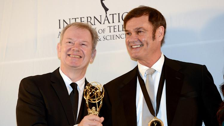 "Australians Zane Bair, left, and Michael McKay after winning the Non-Scripted Entertainment award for ""The Amazing Race Australia"" at the 40th International Emmy Awards,  Monday, Nov. 19, 2012 in New York. (AP Photo/Henny Ray Abrams)"