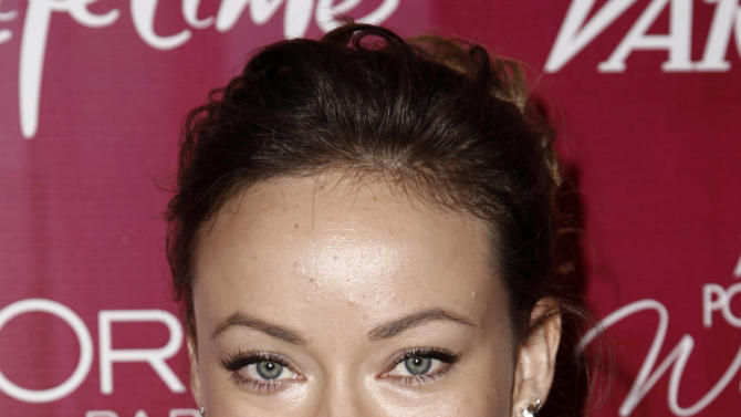 FILE - In this Sept. 23, 2011 file photo, actress Olivia Wilde arrives at Variety's 3rd Annual Power of Women Luncheon in Beverly Hills, Calif. Wilde has finalized her divorce from her husband of eight years. A judge finalized Wilde's split from documentary filmmaker Tao Ruspoli on Sept. 29 in Los Angeles. (AP Photo/Matt Sayles, file)