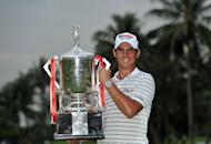 Matteo Manassero of Italy poses with the winner's trophy on day four of the Singapore Open at the Sentosa Golf Club in Singapore, in a handout photo provided by World Sport Group on November 11, 2012. Manassero holed a 12-foot eagle putt on the third play-off hole to claim a dramatic victory over South Africa's Louis Oosthuizen at the Singapore Open on Sunday