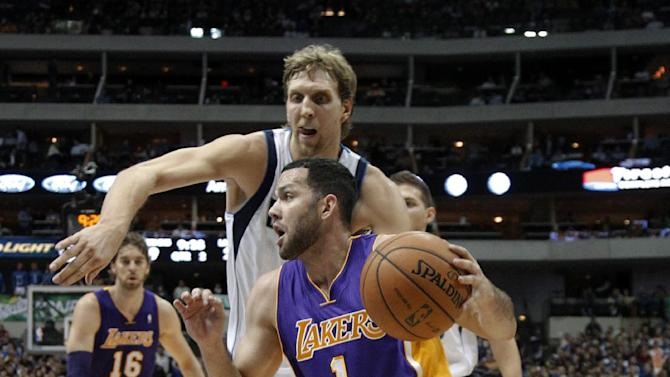 Los Angeles Lakers' Jordan Farmar (1) drives past Dallas Mavericks' Dirk Nowitzki, of Germany, for a shot attempt in the first half of an NBA basketball game, Tuesday, Nov. 5, 2013, in Dallas. Lakers' Pau Gasol (16), of Spain, watches from the rear