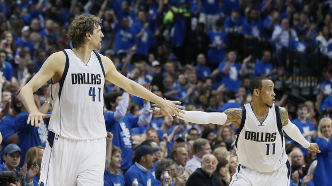 Dallas Mavericks' Dirk Nowitzki (41) and Monta Ellis (11) celebrate a basket against the Houston Rockets during the first half of Game 3 in an NBA basketball first-round playoff series Friday, April 24, 2015, in Dallas. (AP Photo/Tony Gutierrez)