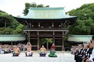 New yokozuna, or sumo grand champion, Harumafuji (2nd left) performs the ceremonial entrance into the ring at Meiji Shrine in Tokyo in September. Only one youngster applied for a sumo apprenticeship ahead of the season-closing tournament, which opens on Sunday, leaving this year's annual total of potential new recruits at a record low of 56