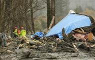 Workers look for victims in the mudslide near Oso, Washington March 25, 2014. REUTERS/Ted S. Warren/Pool