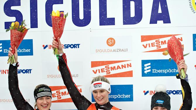 Winner Natalie Geisenberger (C) of Germany, third place winner Erin Hamlin of the US (R) and second place winner Anke Wischnewski (L) of Germany celebrate on the podium following the womens luge World Cup event in the Latvian town of Sigulda on February 19, 2012. AFP PHOTO /ILMARS ZNOTINS (Photo credit should read ILMARS ZNOTINS/AFP/Getty Images)
