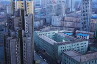 This April 12, 2011 photo shows central Pyongyang, North Korea at dusk. (AP Photo/David Guttenfelder)