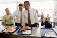 US President Barack Obama orders lunch alongside Alejandro Garcia Padilla (2nd L), a Puerto Rican Senator during a visit to San Juan, Puerto Rico, June 14. With key deadlines looming, the White House vowed to answer critics of the conflict in Libya who have demanded detailed explanations of the cost, legal rationale, and goal of the operations