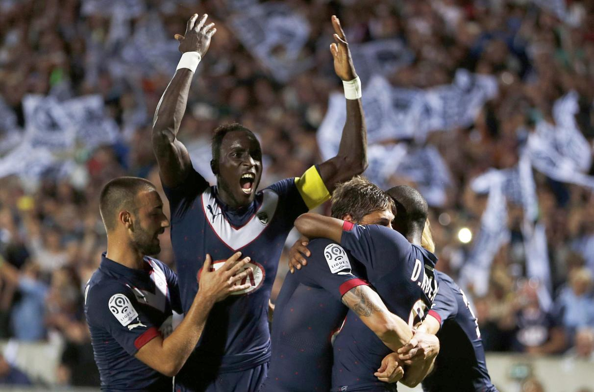 Girondins Bordeaux captain Ludovic Sane celebrates with his team mates after a goal by Diego Rolan Silva during their French Ligue 1 soccer match...