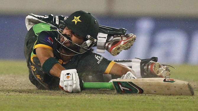 Pakistan's Fawad Alam drives to makes his ground during their match against Bangladesh in the Asia Cup one-day international cricket tournament in Dhaka, Bangladesh, Tuesday, March 4, 2014. (AP Photo/A.M. Ahad)