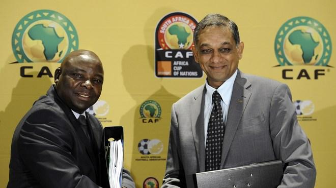 The President Of The South African Football Association (SAFA), Kirsten Nematandani (L), Shakes Hands With The First AFP/Getty Images