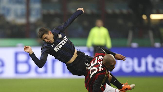 AC Milan midfielder Nigel de Jong, right, of the Netherlands, tackles Inter Milan midfielder Mateo Kovacic, of Croatia, during a Serie A soccer match, at the San Siro stadium in Milan, Italy, Sunday, Dec. 22, 2013