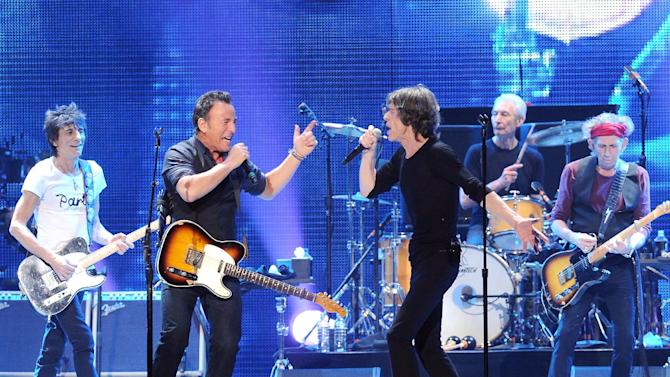 Musician Bruce Springsteen, center left, performs with, from left, Ronnie Wood, Mick Jagger, Charlie Watts and Keith Richards of The Rolling Stones at the Prudential Center in Newark, NJ on Saturday, Dec. 15, 2012. (Photo by Evan Agostini/Invision/AP)